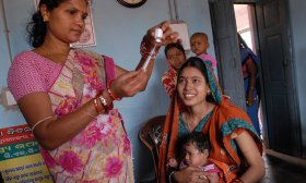 Community health worker gives vaccination