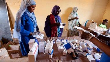 Woman receiving medication from nurses