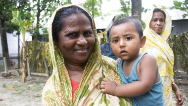 Mother and child wait outside health clinic