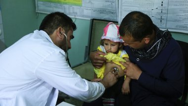 young child gets check-up by a doctor
