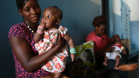 Mother with child at health clinic