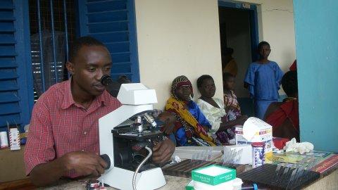 Malaria microscopist in health care facility in Tanzania