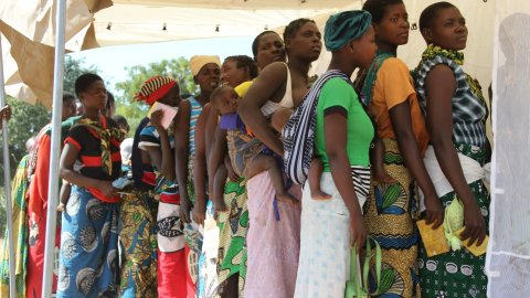 women queue for health services